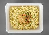 Instant noodles on a gray background.