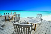 Chairs in beautiful beach jetty in Maldives
