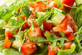 foto of iceberg lettuce  - salad with fresh cucumbers tomatoes and arugula - JPG
