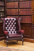 image of settee  - Traditional Chesterfield chair in classical library room - JPG