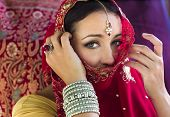 Mysterious Woman with Beautiful Eyes and Veiled Face in Red Sari
