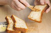 Butter Spread On Bread Slice At Breakfast