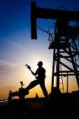 Oil worker silhouette