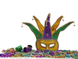 stock photo of mardi gras mask  - A group of mardi gras beads an mask with copy space - JPG
