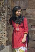 Young Indian Girl Posing At Qutub Minar In Delhi