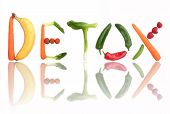 stock photo of vegetables  - Detox spelt using fruits and vegetables as letters over a white background - JPG