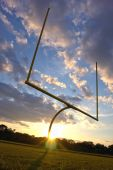 American Football Goal Posts At Sunset