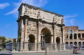 ROME, ITALY - APRIL 17: the Arch of Constantine and the Coliseum on April 17, 2013 in Rome, Italy. T