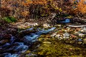Beautiful Clear Waterfalls and Fall Foliage On The Guadalupe River, Texas.