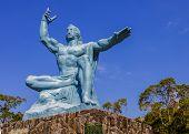 Nagasaki, Japan - November 14 2013: Nagasaki Peace Statue, The Statue's Right Hand Points To The Thr