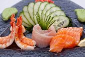foto of dragon-fish  - Sushi roll on black plate with wasabi on a side - JPG