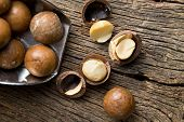 macadamia nuts on scoop on wooden table