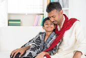 Portrait of Asian Indian father and son at home.