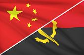 Series Of Ruffled Flags. China And Republic Of Angola.