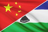 Series Of Ruffled Flags. China And Kingdom Of Lesotho.