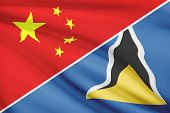 Series Of Ruffled Flags. China And Saint Lucia.