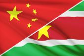 Series Of Ruffled Flags. China And Republic Of Suriname.