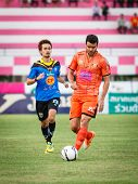 Sisaket Thailand-may 21: Victor Amaro Of Sisaket Fc. (orange) In Action During Thaicom Fa Cup Betwee