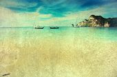 Vintage holiday background -  Exotic beach view and traditional longtail boats in Thailand