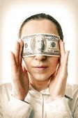 image of lobbyist  - Woman with a hundred dollars in her eyes - JPG
