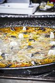 traditional Spanish paella, seafood and rice dish made �?�¢??�?�¢??with wood fire