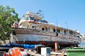 SYMI, GREECE - JUNE 18, 2011: Lazy Days, a former excursion boat, lays crumbling in the boatyard at