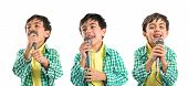 Kid Singing Over White Background