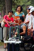 Beijing, China - Jul 17, 2011: . Women And Men Are Singing In Jingshan Park. It's A Popular Traditio
