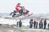 Sportsman jump on snowmobile