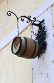 hanging wine barrel on ancient building