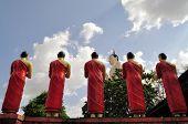 Buddhist monks praising Buddha