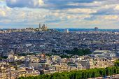 View Of Paris, The Hill Montmartre And The Sacre Coeur Basilica From The Eiffel Tower