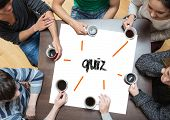 The word quiz on page with people sitting around table drinking coffee