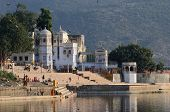 people at holy ghats in the evening at sacred Sarovar lake ,India