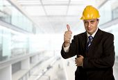 businessman with his thumb up at the office