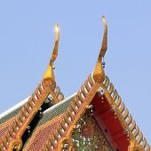 picture of gable-roof  - gable apex on temple roof with blue sky background - JPG
