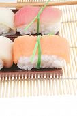Japanese Cuisine - Different Types of Nigiri Sushi : Tuna (maguro) Salmon (sake) and Eel (unagi) wit