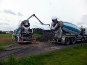 Mixer And A Large, Self-propelled Concrete Pump With A High Arm While Pumping The Concrete