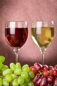 Full Wine Glasses And Grapes