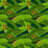 Tropical palm leaves with red Heliconia flowers, seamless pattern