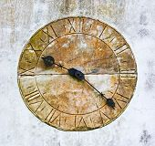 Stone Clock On A Wall