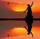 Woman Dancing at Sunset