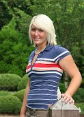 Platinum Blonde Teenager In Striped Shirt