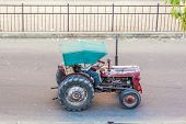Farmer On A Tractor In The Morning