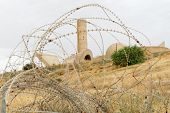 Monument to the Negev Brigade in Beer Sheva Israel seen through the barbed wire