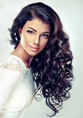 pic of flowing hair  - Model brunette with beautiful long curled hair and red lips - JPG