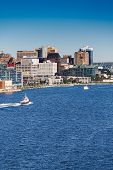 Tugboat Sailing Past Halifax Vertical