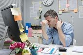 Depressed Office Worker At His Desk
