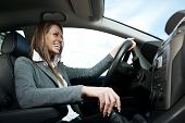 Young Smiling Woman Driving