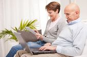 Mature Couple Using Mobile Devices